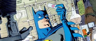 25 Years Ago This Month: Like any good detective, Batman does lab work on the cover to Detective Comics...
